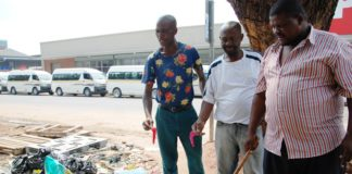 Mabopane taxi drivers hold some used condoms they say were dumped by magoshas.